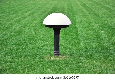 lamppost with three lights in the park