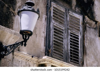 Lamppost and window with wooden shutters