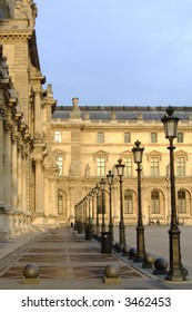 lampposts at the louvre during sunset