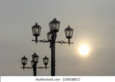 Lampposts on the street early in the morning.
