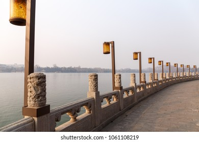 Lamps along a lakeside promenade in Beihai Park, Beijing, China in March 2018.