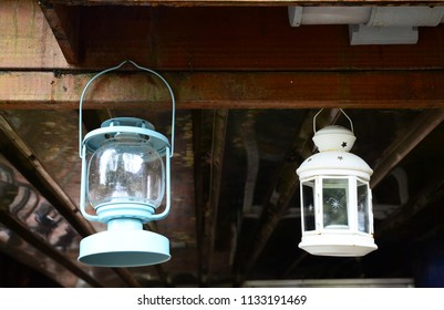 Lamps hanging on wooden ceiling