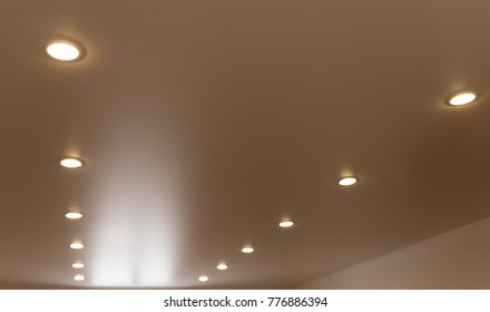 lamps on a stretch ceiling in a room