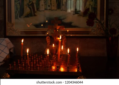 Lampstand In Church with burning candles. Church attribute. Christianity and faith Concept. Religious temple. Inside of the Russian Ortodox Church