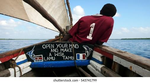 LAMU, LAMU COUNTY/KENYA - FEBRUARY 11th 2009 - A crew member aboard a traditional dhow on a trip around the Lamu archipelago.