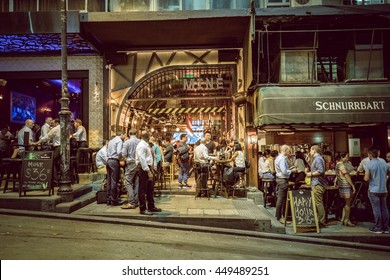 Lan Kwai Fong, Central, Hong Kong - July 08, 2016: People drinking, dinning in the famous place Lan Kwai Fong after work. Photo with color tone tuned.