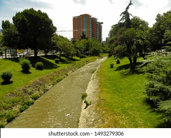 Lana river and perspective of Zhan D'Ark boulevard in center of Tirana, Albania.