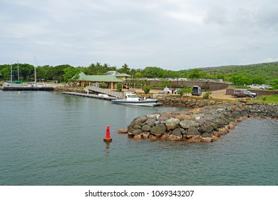 LANAI, HAWAII -31 MAR 2018- View of the Manele Small Boat Harbor, where ferry boats arrive to Lanai from Maui on the Pacific Ocean. It is common to see spinner dolphins in the water.