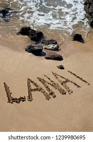 Lanai written on the beach by the ocean