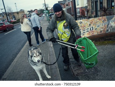 lancashire, England, 05/05/2017, Wayne dixon and koda the Northern Inuit Dog walking around england cleaning up Street litter and fly tipping on the streets for charity. raising money for charity.