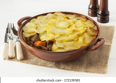 Lancashire Hotpot - regional speciality Lancashire Hot Pot, lamb and vegetables topped with sliced potatoes and oven baked. Often served in gastro pubs.