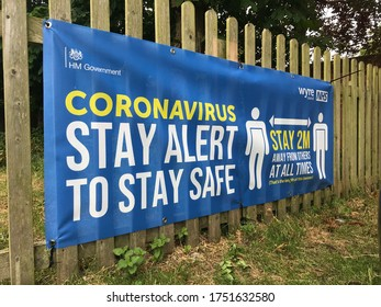 Lancashire, UK - 08.06.20 : Coronavirus Stay Alert to Stay Safe signage on fence, pointing out to stay at 2metres at all times. HM Government NHS funded sign whilst lockdown pandemic eases in England