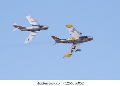LANCASTER, CA/USA - MARCH 24, 2018: image showing a Mikoyan-Gurevich Mig-15 and North American F-86F Sabre 'Jolley Roger' flyover.