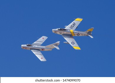 LANCASTER, CA/USA - MARCH 25, 2018: Mikoyan-Gurevich Mig-15 and North American F-86F Sabre 'Jolley Roger' flyover.