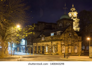 Lancaster, England, UK - November 11, 2017: The Edwardian Baroque clock tower of Lancaster Town Hall, seat of Lancaster City Council, rises above the houses of the Northern city.