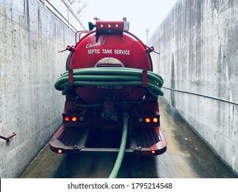 Lancaster, Ohio/USA-February 2020: A septic tank truck backed up to a building to drain an indoor septic tank.