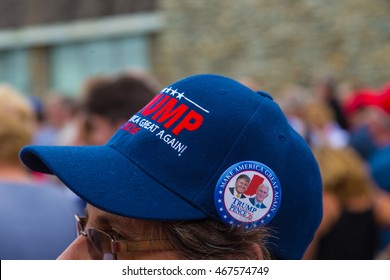 Lancaster, PA - August 9, 2016: Following the Governor Mike Pence political rally, a supporter wears aTrump Pence Button on Make America Great Again Hat.