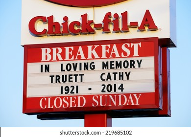 LANCASTER, PA - SEPTEMBER 20: Chick-fil-A sign displays a memorial to founder Truett Cathy outside the restaurant in Lancaster, PA on September 20, 2014. S. Truett Cathy died on September 8, 2014.