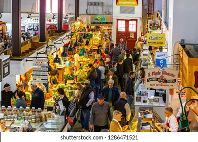 Lancaster, PA, USA - April 11, 2015: Customers shop for fresh products in Lancaster Central Market.