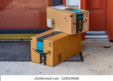 Lancaster, PA, USA - December 13, 2018:  Two cartons from Amazon Prime delivered to a residential address.
