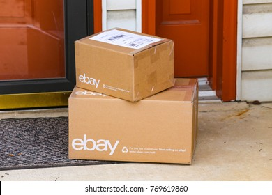 Lancaster, PA, USA - December 4, 2017: Multiple ebay packages delivered to a residential front door.