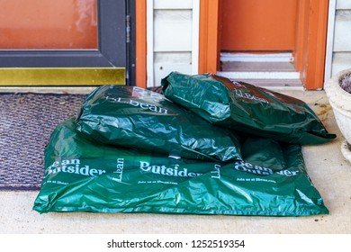 Lancaster, PA, USA - December 7, 2018:  Closeup of LL Bean packages delivered at a residential door.