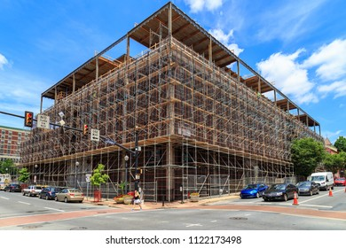 Lancaster, PA, USA - June 25, 2018: Construction scaffolding on a commercial building undergoing a major rehab project.