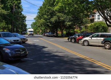 Lancaster, PA, USA - June 25, 2018: Back-in Angle Parking on a Lancaster City street.