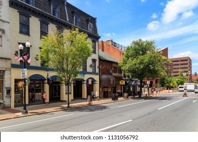 Lancaster, PA, USA - June 25, 2018: On a main street in downtown Lancaster, the city has older commercial buildings.