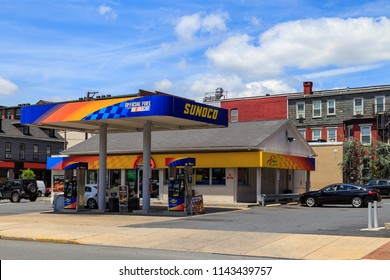 Lancaster, PA, USA - June 25, 2018: A Sunoco A-Plus convenience store  in downtown Lancaster, PA offers gas, limited groceries, and fast food items.