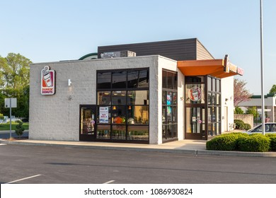 Lancaster, PA, USA - May 8, 2018: Exterior of Dunkin' Donut fast food bakery and store, which offers fresh doughnuts, sandwiches, coffee and beverages at over 12,000 locations.