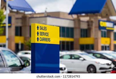 Lancaster, PA, USA - September 2, 2018: Signs at CarMax, the largest used car dealership in the USA.