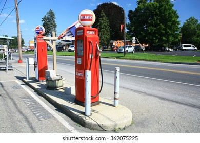 Lancaster, Pennsylvania (PA), USA. 07.12.2015. Vintage and retro gas station with two red pumps in Lancaster, in Amish country, near an Antiques store.