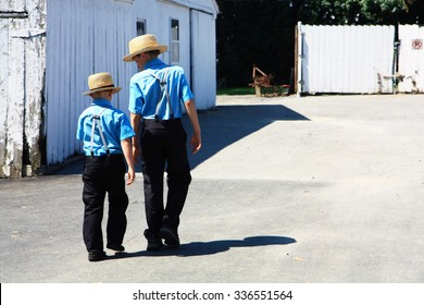 Lancaster, USA. 07.10.2015. Two Amish boys walking together to an Amish meeting near Lancaster (Pennsylvania)