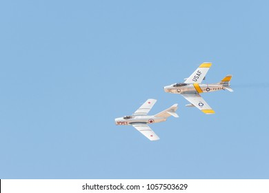 Lancaster, USA - March 24, 2018: F-86F SABRE and Mikoyan-Gurevich MiG-15 on display during Los Angeles County Air Show at William J. Fox Airfield.