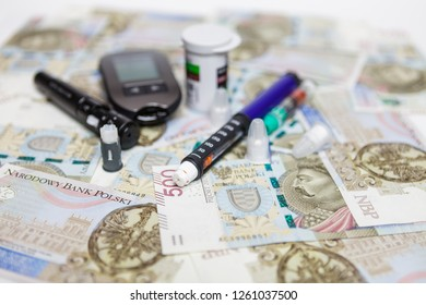Lancet with spare needles, glucometer, strips, box of spare strips, pen injector, spare insulin and pen needles on polish money banknotes 500 PLN