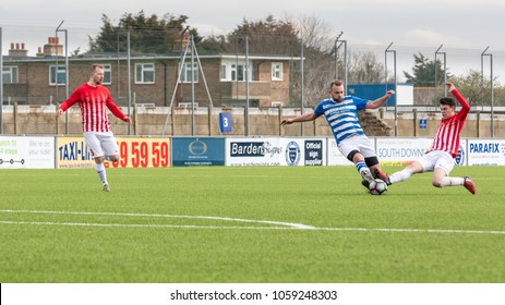 Lancing, Sussex, UK; 1st April 2018; Sunday League Football Match Between Hillside Ranger FC and Forest Recommission FC. Opponents Tackle for the Ball