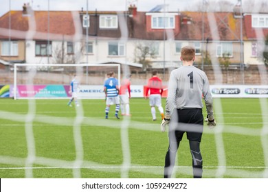 Lancing, Sussex, UK; 1st April 2018; Sunday League Football Match Between Hillside Ranger FC and Forest Recommission FC. Shot From Behind Goal with Backs of Goalkeeper and Other Players