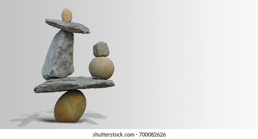 Land art in balancing stones on a gray background.