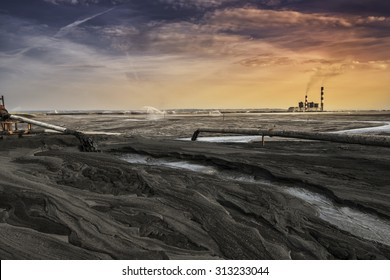 A land of ash. Hundreds of square miles covered with lifeless ash. Ash waste is produced by burned coal in a power plant.