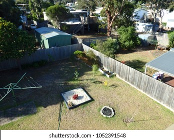 land of backyards divided in 4 by wooden fence aerial view from above