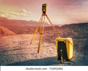 A land and construction surveyor equipment. A robotic total station theodolite standing on a tripod next to its box. Equipment used for mapping,  and construction of buildings and infrastructure