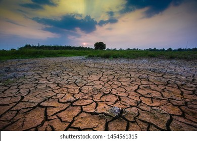 Land with dry and cracked ground. Climate change, dry lake.Green house effect Global warming caused by changes in the Earth's atmosphere