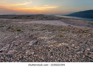A land formation in the shape of an isosceles triangle on Pag island, Croatia. Rock inside the formation are different from the surroundings, and it is believed to be a site of a UFO landing.