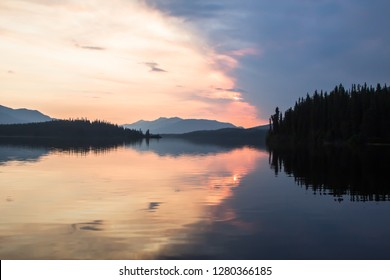 The Land of the Midnight Sun. This photograph was captured on the summer solstice (around midnight) at Big Salmon lake in Yukon Territory.