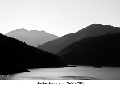 Land and mountains in black and white