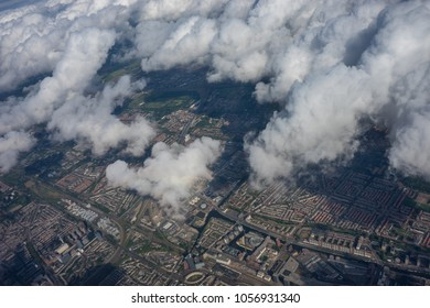 Land on earth viewed from plane in sky with clouds, window on aeroplane