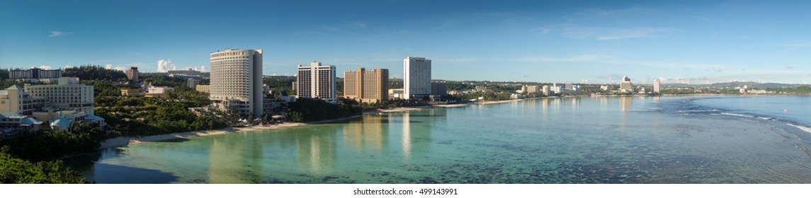land scape of guam beach, hotel and buildings along seashore, panorama view of beach