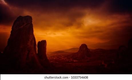 land spikes under an orange evening sky