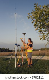 Land Surveyor with GPS unit.